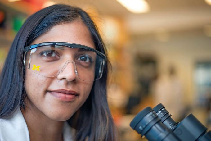 Researcher in U-M branded eye protection