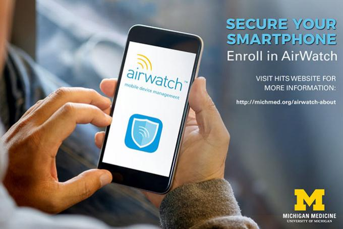 A man holds a smartphone. The AirWatch logo is on the screen.