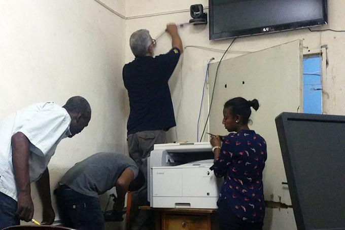 Bob Riddle installs equipment to help enable videoconferencing in Ethiopia.