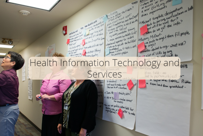 Three Health Information Technology and Services staff members make plans for improving the delivery of services.