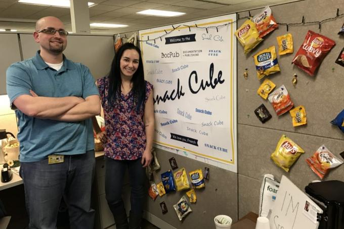 Craig French and Nicole Jacob are standing in front of a snack selection.