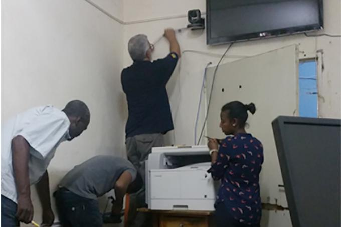 Bob Riddle,  software engineer for Health Information Technology & Services (HITS), configures videoconferencing infrastructure with colleagues in Addis Ababa, Ethiopia.