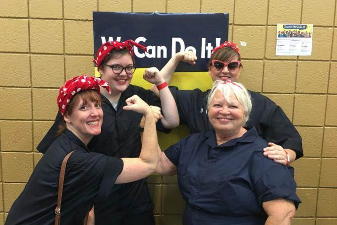 Kimberly Bonner of Health Information Technology and Services poses with her family at the recent world record setting gathering of people dressed as Rosie the Riveter.