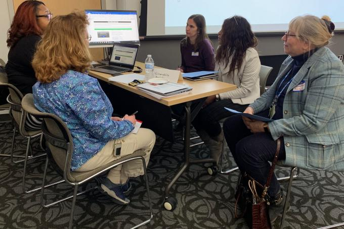 Staff members learn about cybersecurity.