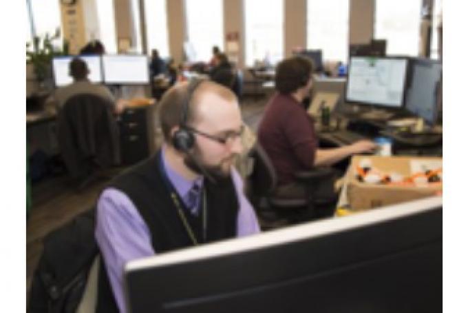 HITS Service Desk staff members assisting Michigan Medicine clients.